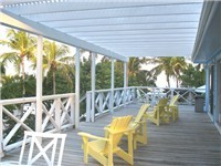 Lanai covered wraparound deck with furniture for both relaxing and dining. Enjoy speakers along exterior of Tahiti Sunset so dance in the moonlight! - enjoy island music for sunsets and alfresco dinin