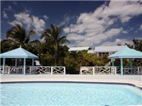 The freshwater pool at the Hope Town Hideaways offers four gazebos, wonderful views as well as patio furniture including outdoor tables and chairs as well as loungers.