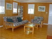 The cozy living area will allow you to relax during the day.  At night the futon can be turned into a Queen size bed.