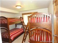 Kids Room with 2 sets of bunk beds + 1 extra twin trundle that rolls out from underneath
