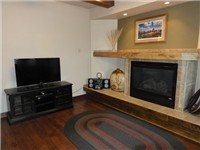 Large flat screen + gas fireplace in living room