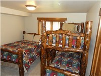 2nd bedroom with full bed and bunk bed