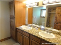 Master Bath with his and hers sinks + slab granite counters!