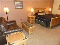 Master Bedroom w/King Bed, flat screen TV + extra sitting area!