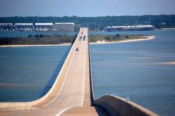 Just 33 miles south of Mobile, Alabama, Dauphin Island is accessible from I-10 and I-65 via the Dauphin Island Bridge. There is also car ferry service to/from nearby Ft Morgan, AL (Gulf Shores area).