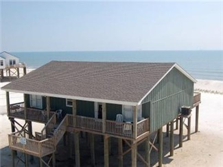 """Beach Break"" is a second tier beach house located right on the sandy Gulf of Mexico Beach. There are no streets to cross, you are right on the beach. There is one house between this home and the wate"