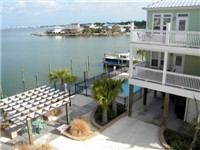 This is the view from the balcony off the Master Bedroom. The pool, dock and boat slips are visible below.