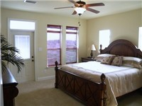 Spacious Master Suite with King bed and private bathroom with garden tub.