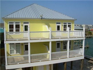 This Dauphin Island vacation rental has a boat slip and pool access. May be pet friendly, please inquire.