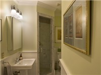 The downstairs powder room is a full bath room for you enjoyment.