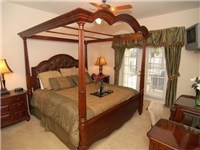 The Master bedroom houses a lavishly furnished King size 4 poster bed.....