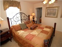 The Master bedroom houses a lavishly furnished King size bed.....