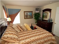 This Queen size bedroom complements the other room