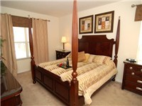 The Master bedroom houses a lavishly furnished Kin