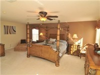 The Master bedroom in Carousel is very spacious, and features a King size 4 poster bed, chaise longue, 32