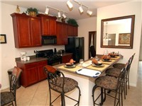 The fully equipped kitchen has everything you could possibly need, including a small breakfast bar....