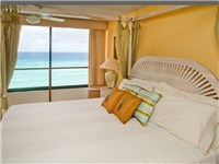The king bedroom has sea view and en suite bath