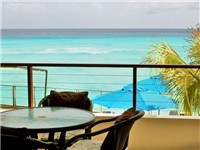 Overlook the beautiful Caribbean Sea as you dine or relax with a beverage. This is the upper level of this two-level apartment.