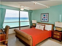 The queen bedroom overlooks the Caribbean Sea