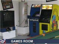 Game Room with pool table, arcade games and TV