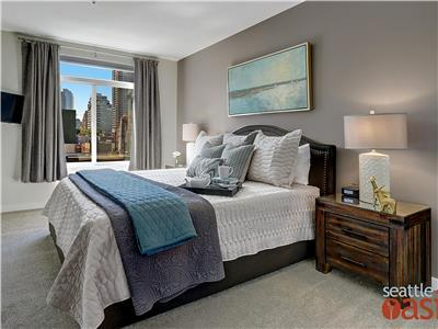 Bedroom has view of city skyline,