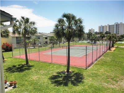 View of tennis courts from sunning deck.