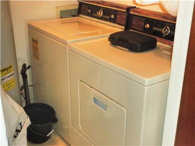 Full sized washer and dryer. Utility room inside.