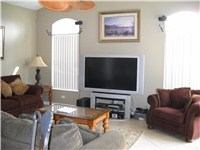 Family room off kitchen with big screen TV