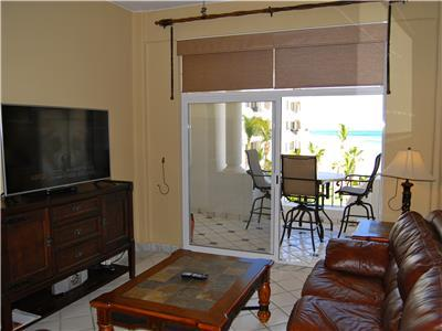 Living room with ocean view and satellite TV