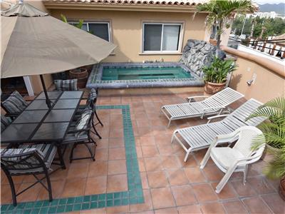 Large furnished patio with Jacuzzi