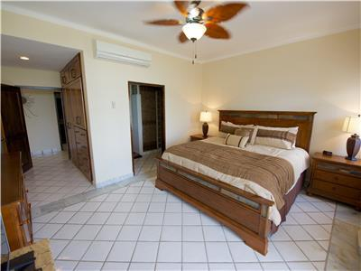 The master bedroom has king size bed and bathroom