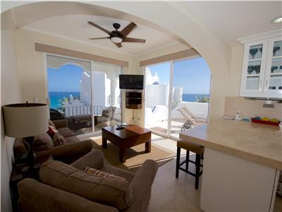 Family room with satellite television and views