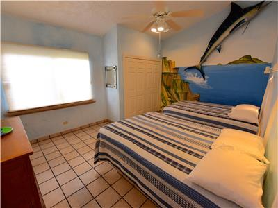 The third bedroom has two full size beds