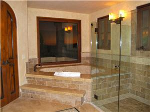 The Master bathroom has a large custom bathtub