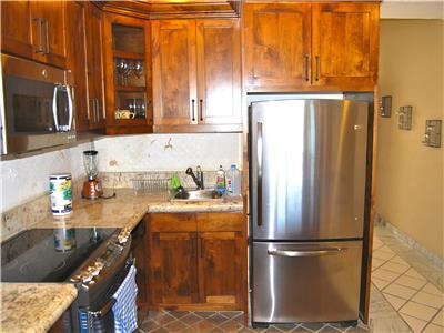Newly remodeled kitchen with custom cabinets