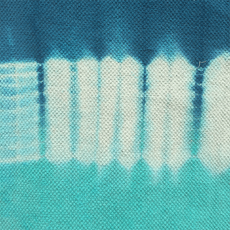 blue-and-turquoise-tie-dye-rug-detail-shopceladon