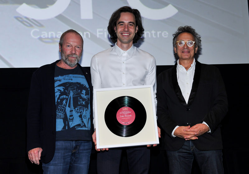 Liam Titcomb (centre) with Gary Slaight (left) and Marc Jordan (right) accepting his certificate at the 2015 Slaight Music Residency Showcase.