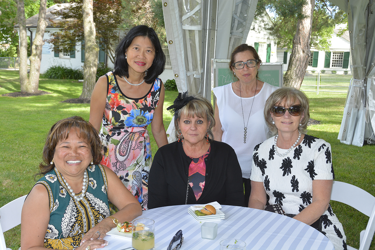 5 Women sitting at a table at CFC Garden Party