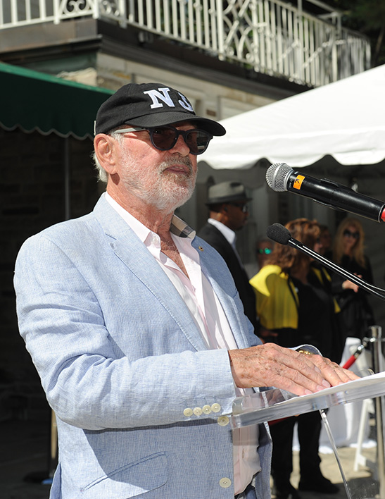 Norman Jewison standing at podium at CFC BBQ