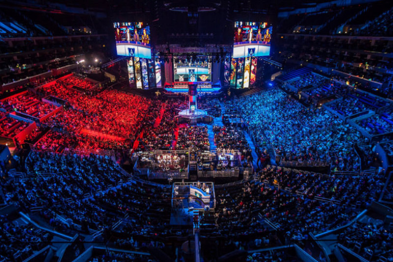 Huge sold-out arena watching esports on giant screens