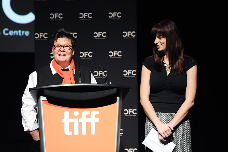 Showcase co-hosts Kathryn Emslie, Chief Programs Officer, and Erica Proudlock, Manager, Film & Actor Programs standing at podium before Showcase gets underway.