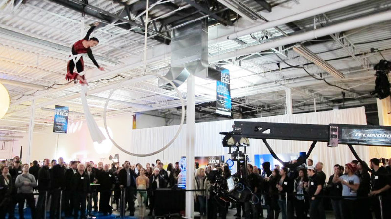 acrobat hanging from showroom ceiling