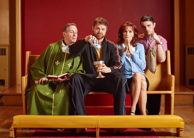 Four people sitting on a church pew