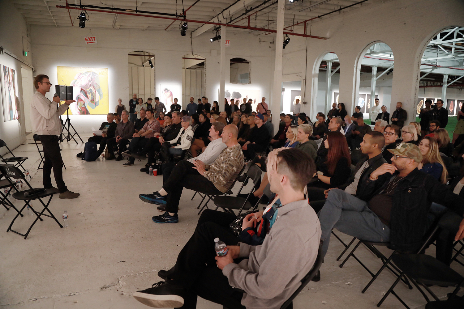 14th Factory founder and artist Simon Birch kicks off the at-capacity Collisions salon.