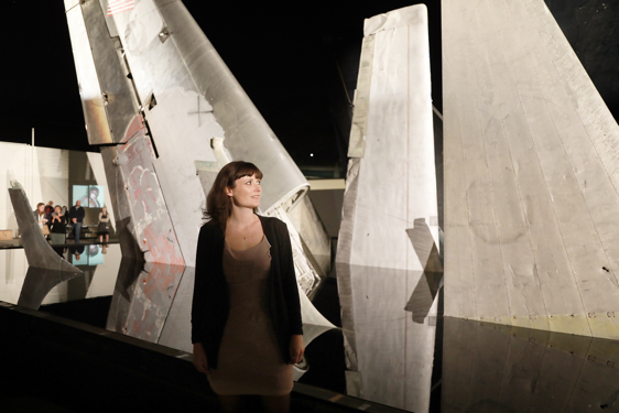 Woman standing next to art installation