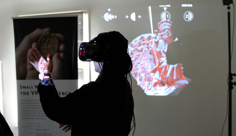 A woman wearing a virtual reality headset.