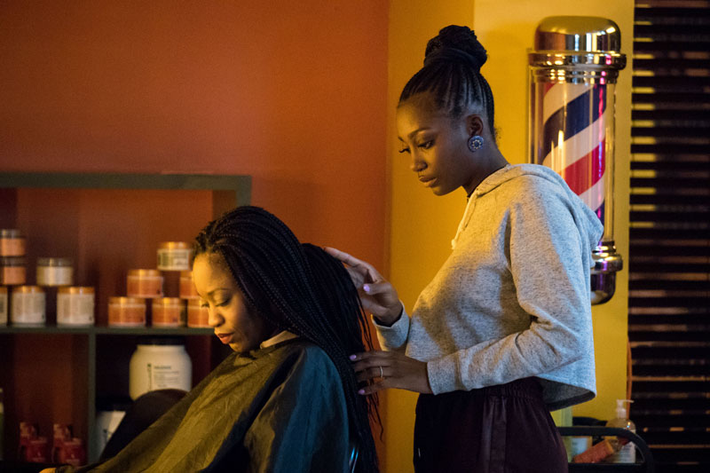 A woman gets her hair done at a salon.
