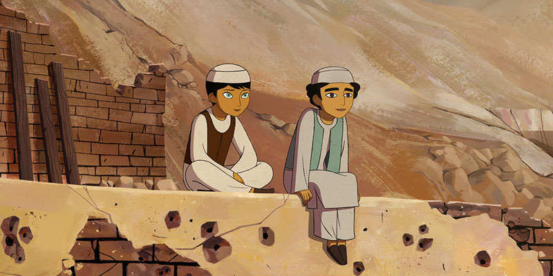 Animated film still of two boys sitting on a desert city ledge looking out into the distance.
