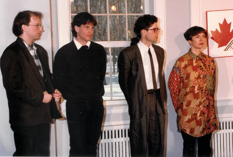 Four people standing at the front of a room
