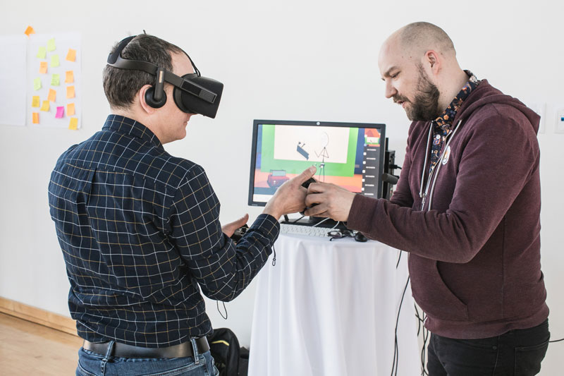Two individuals experiencing a VR demo